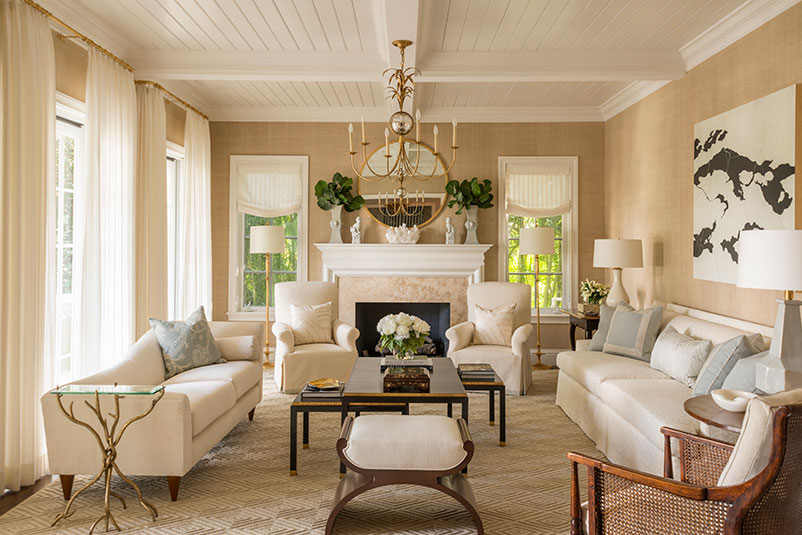 The success of this neutral room by the incredibly talented  Phoebe Howard , is in the use of texture. A planked and coffered painted ceiling is paired with grasscloth covered walls and a geometric woven sisal rug. Unlined textured linen window treatments and a caned chair layer more subtle texture into the space.