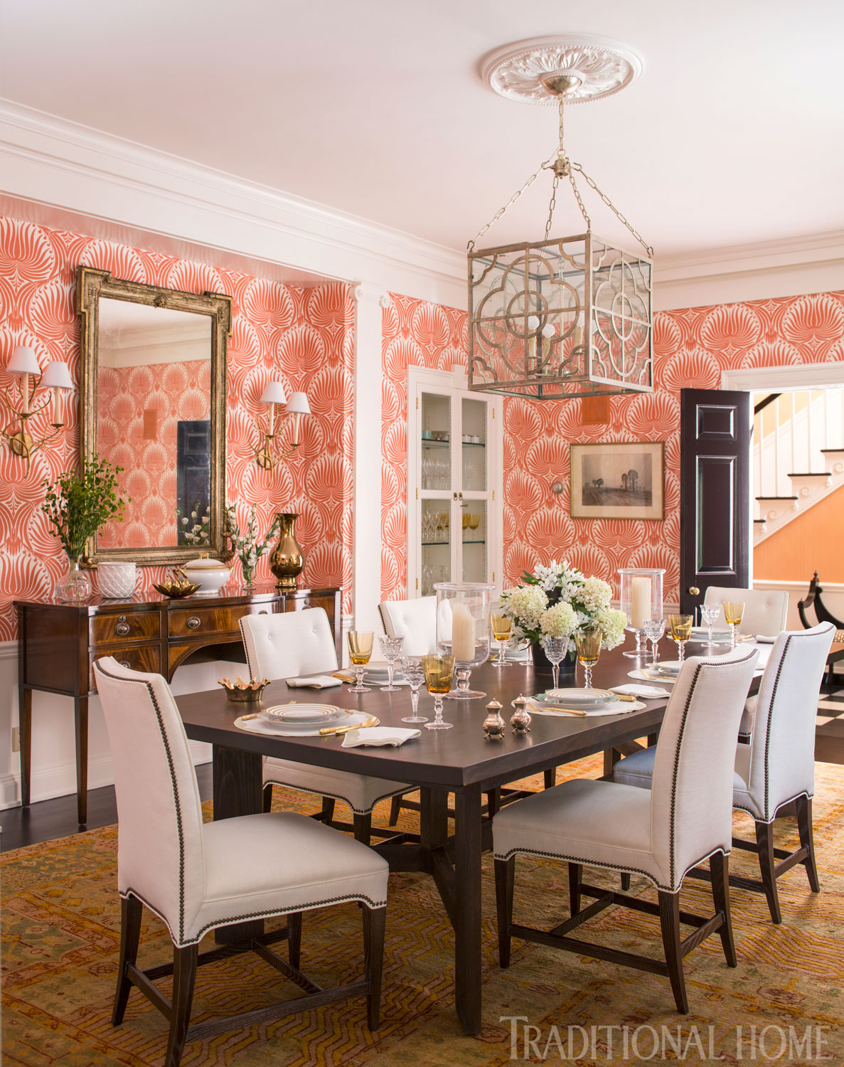 Coral wallpaper enlivens this dining room. Design by  Christina Murphy , Photo by  John Bessler , via  Traditional Home