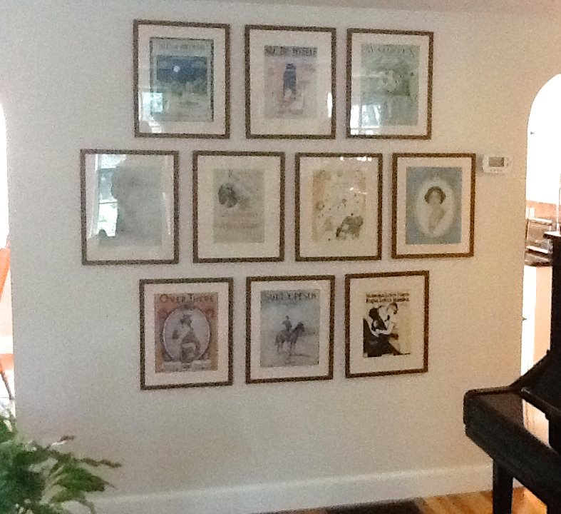 This wall of favorite pieces of framed piano music gives this homeowner joy every time she looks at it!
