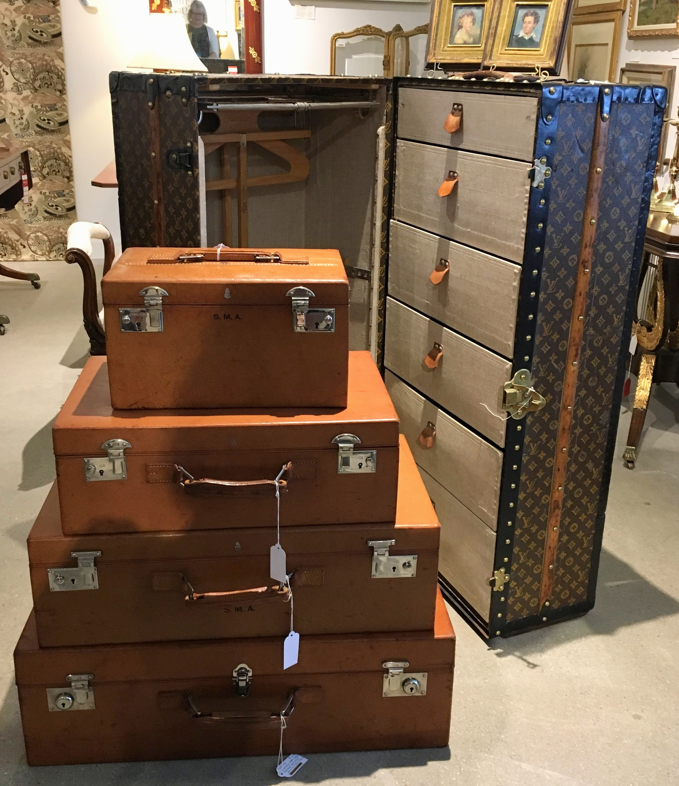 A stack of monogrammed leather suitcases and a Louis Vuitton steamer trunk. If your initials are SMA it has your name on it. Literally!