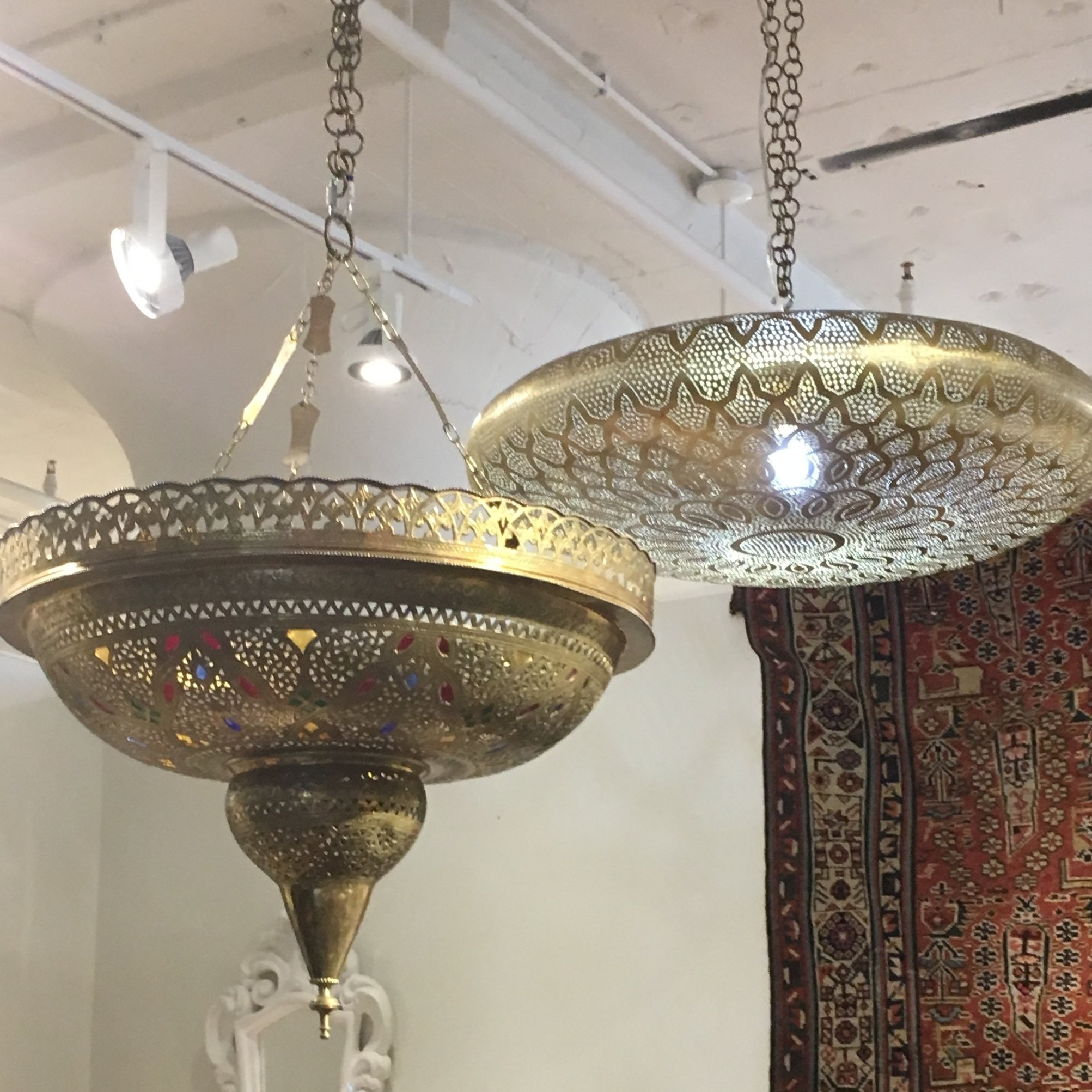 Pierced metal pendants with a Moroccan flair