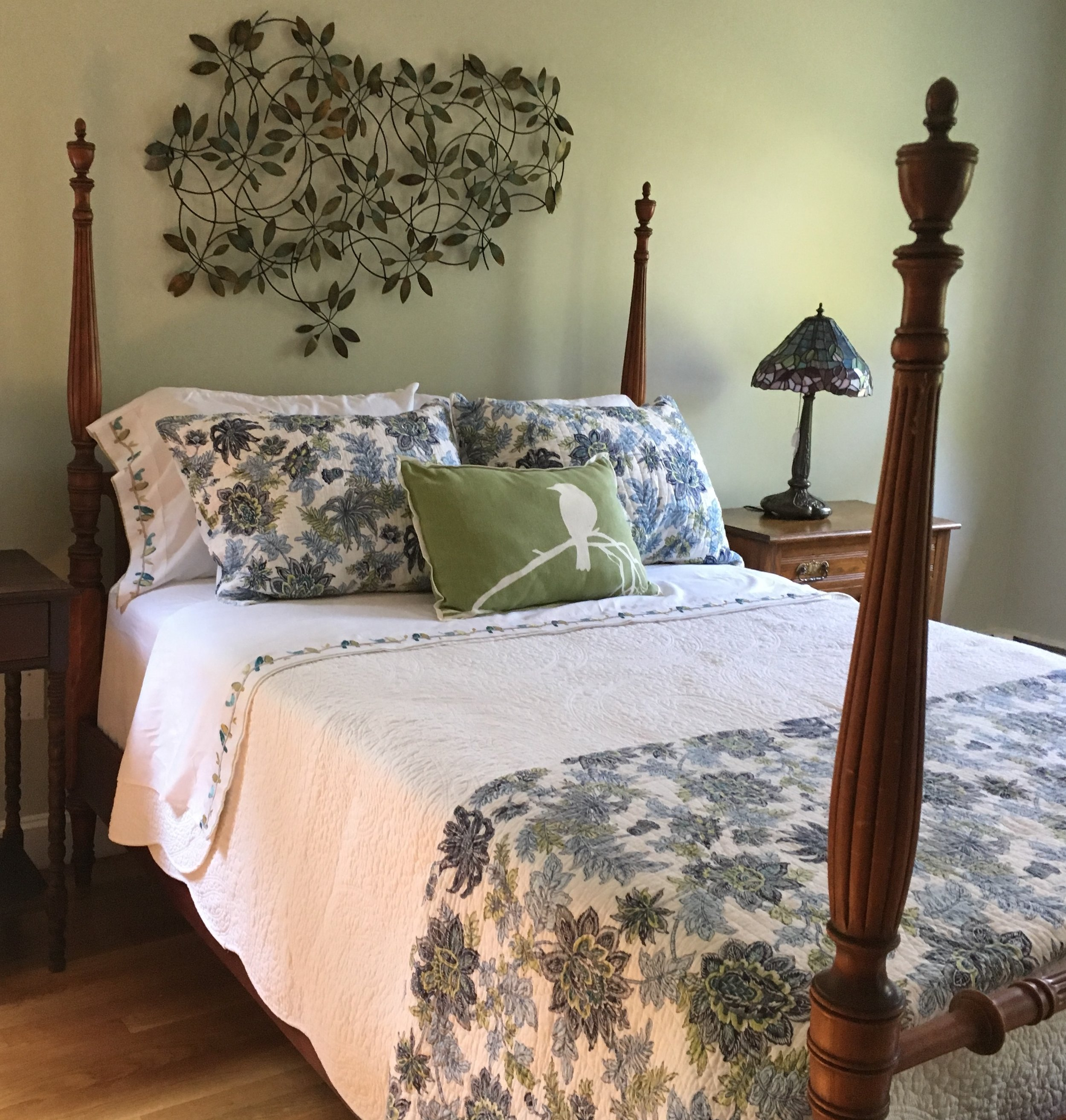 Bed styling - pattern on shams and folded coverlet add just the right amount of pretty pattern without overwhelming.
