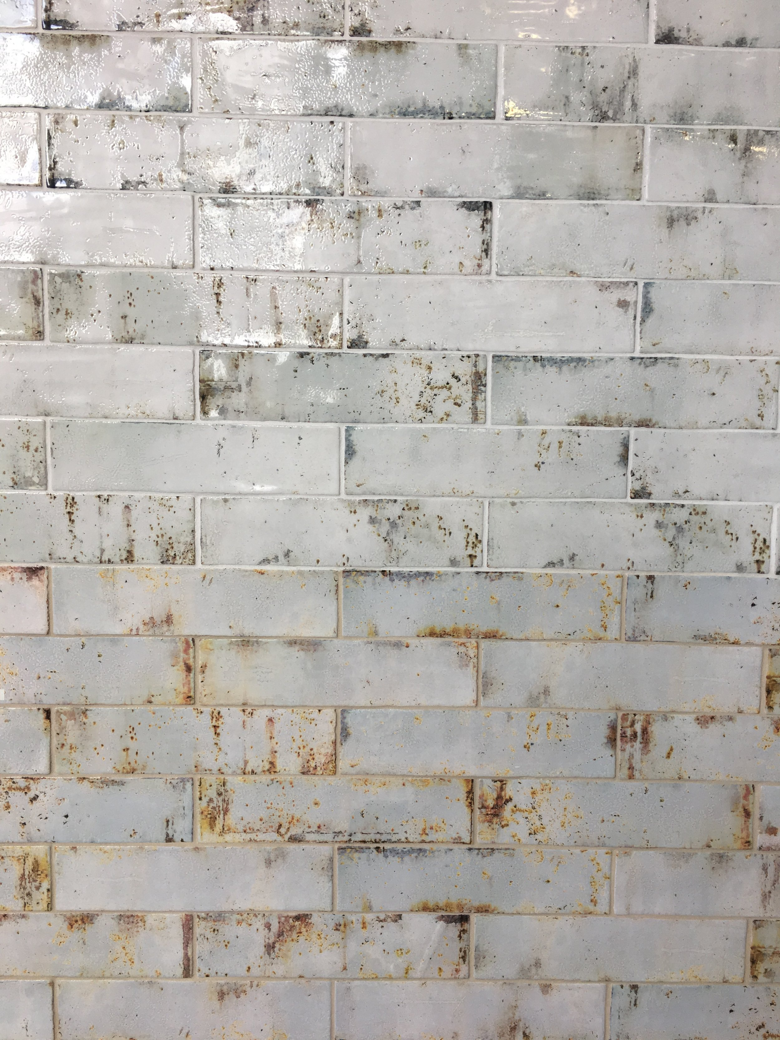 """This next level """"distressed"""" (or is it distressing?) tile comes in both black mold and yellow mold.versions. Lovely."""