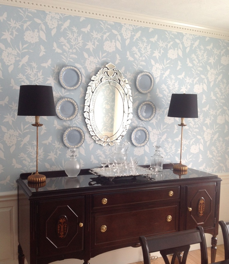 A pair of tall skinny buffet lamps in a classic dining room