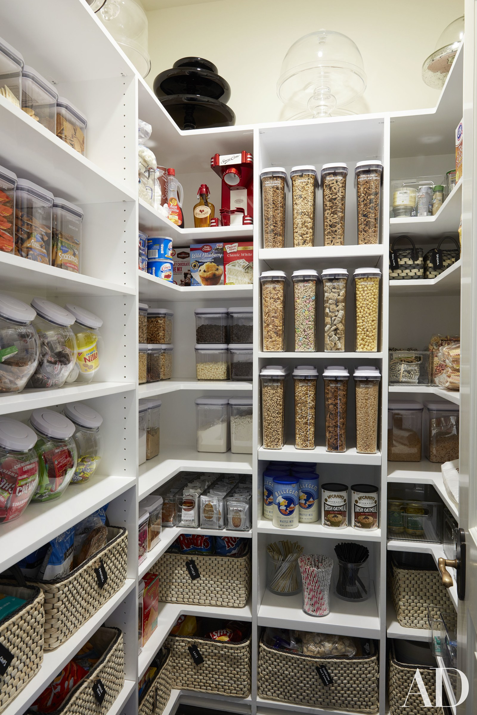Baskets and clear containers in this pretty pantry Image via  AD  photo by  Roger Davies