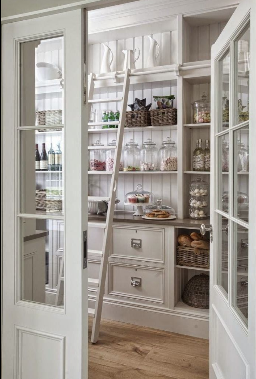 How gorgeous is this pantry by Hayburn and Co.! Complete with a rolling library ladder to reach the top shelves photo via  House Beautiful