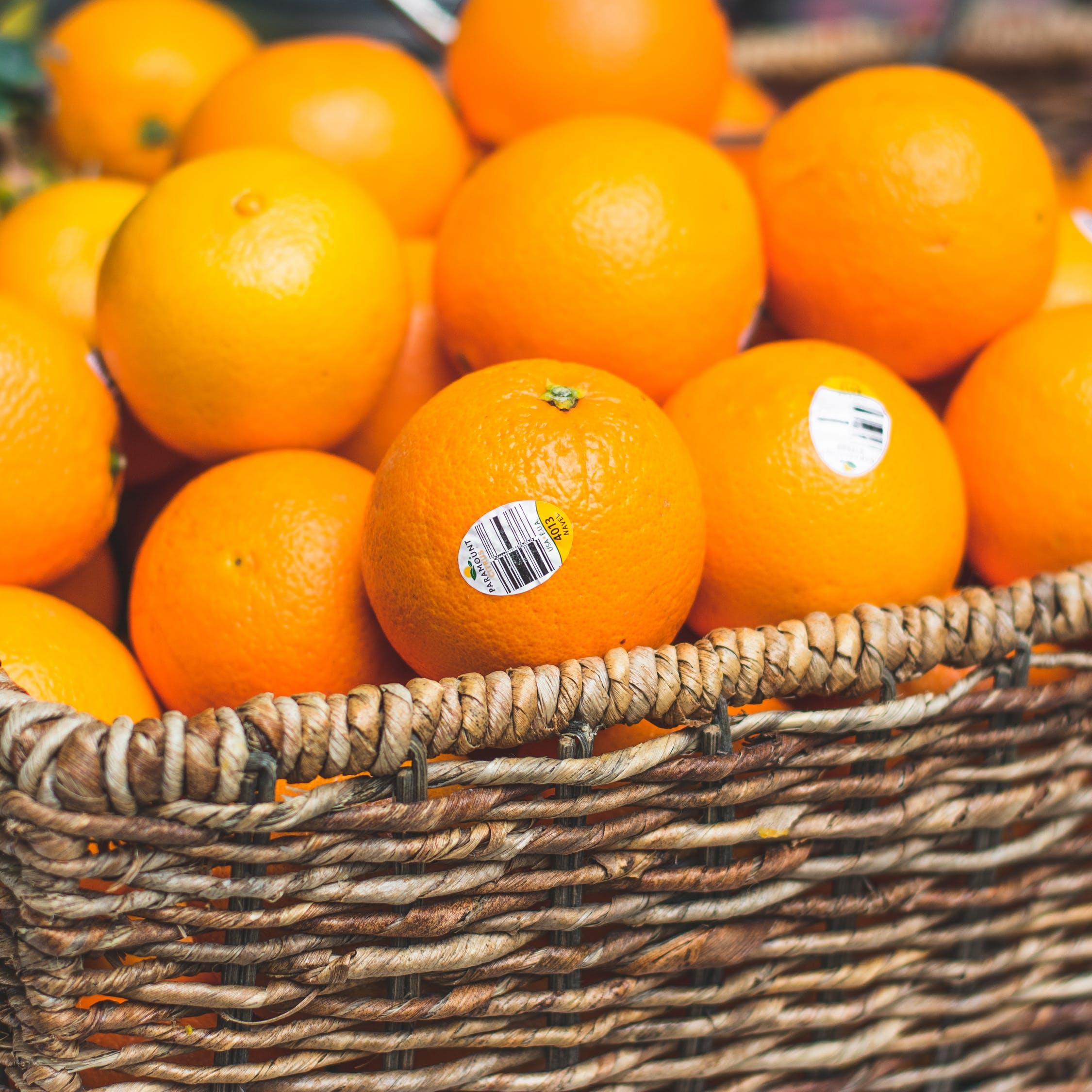 Oranges in an open basket, photo by Malcom Garret