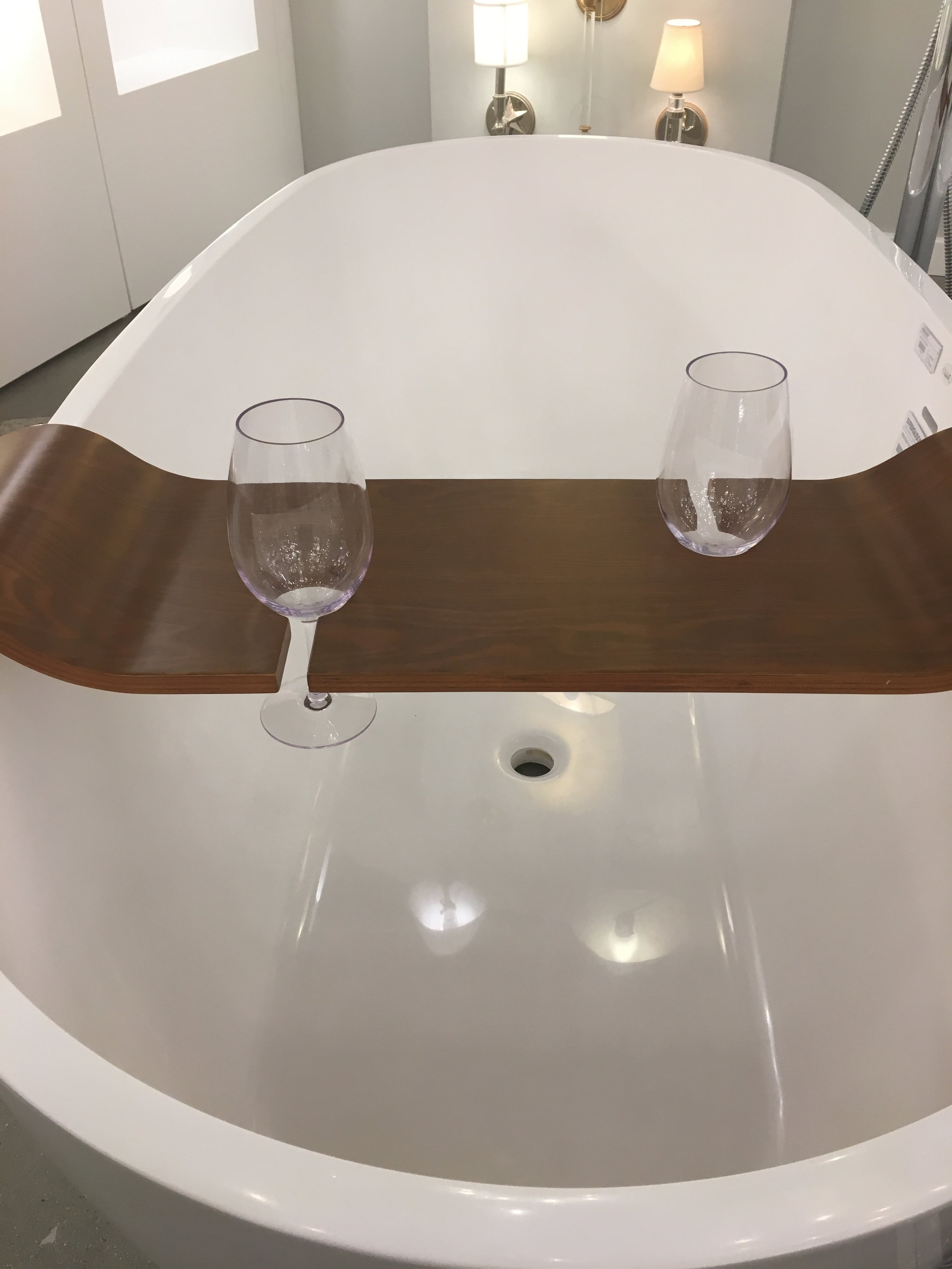A bit of aspirational accessorizing with this bathtub wineglass holder…for two?!