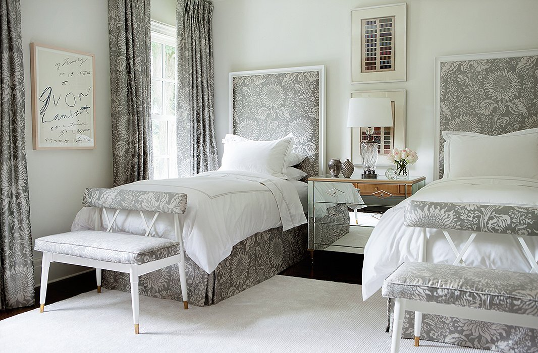 For a guest room in her own home,   Suzanne Kasler   dressed the beds and windows in a pretty gray Brunschwig fabric that has a timeless appeal. Image via   One Kings Lane