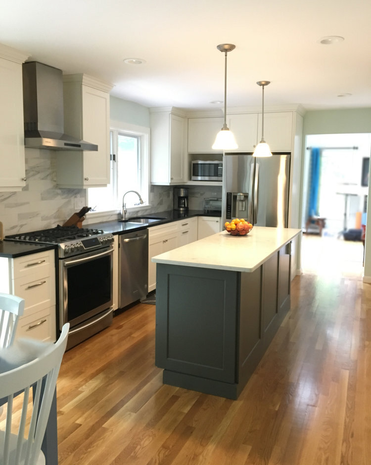 A charcoal gray island in a white kitchen (for before and after pics of the remarkable transformation this kitchen underwent, click  HERE )