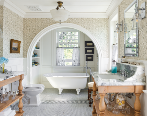 This beautiful bathroom by   Philip Mitchell   features a Christopher Farr wallcovering, marble sink surrounds, and mosaic tile flooring all in shades of gray for a perfect pairing with the architecture of this 18th century Nova Scotia cottage. Photo by   Annie Schlechter   via   Veranda