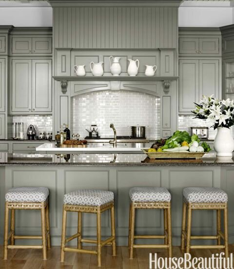Cabinets painted Chelsea Gray pair with a sparkling white backsplash and dark counters in this Florida retreat. Design by  Marshall Watson  , Photo by   Francesco Lagnese  , via   House Beautiful
