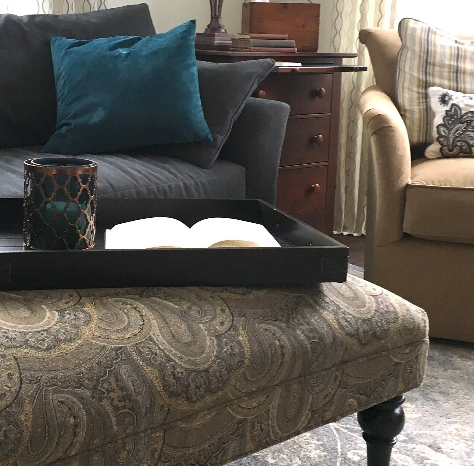 We used our client's favorite neutrals on her new furnishings - menswear inspired gray wool paired with camel micro corduroy and an ottoman that mixes shades of gray and camel in a gorgeous paisley - all set on a new-traditional grey patterned area rug with touches of beige and teal.