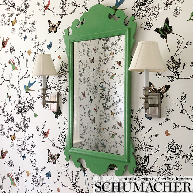 Schumacher wallcovering, interior design by   Sheffield Interiors  . A classic Chippendale mirror is anything but stodgy dressed in fresh green paint and pairs beautifully with this striking colorful wallpaper.