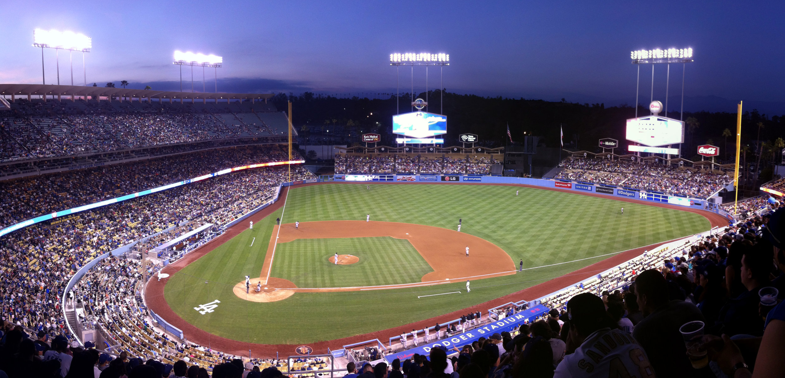 Dodger Stadium (Los Angeles) - Like most of my contemporaries (urban hipsters), I have a thing for mid-century modern design. Dodger Stadium is a lovely example of this architectural period. After my brother's wedding in San Francisco, my dad and I took a road trip to Yosemite and then down the coast to LA. We saw a game about a week after Yasiel Puig came up - and people were going NUTS. I think we saw him hit two home runs that day.