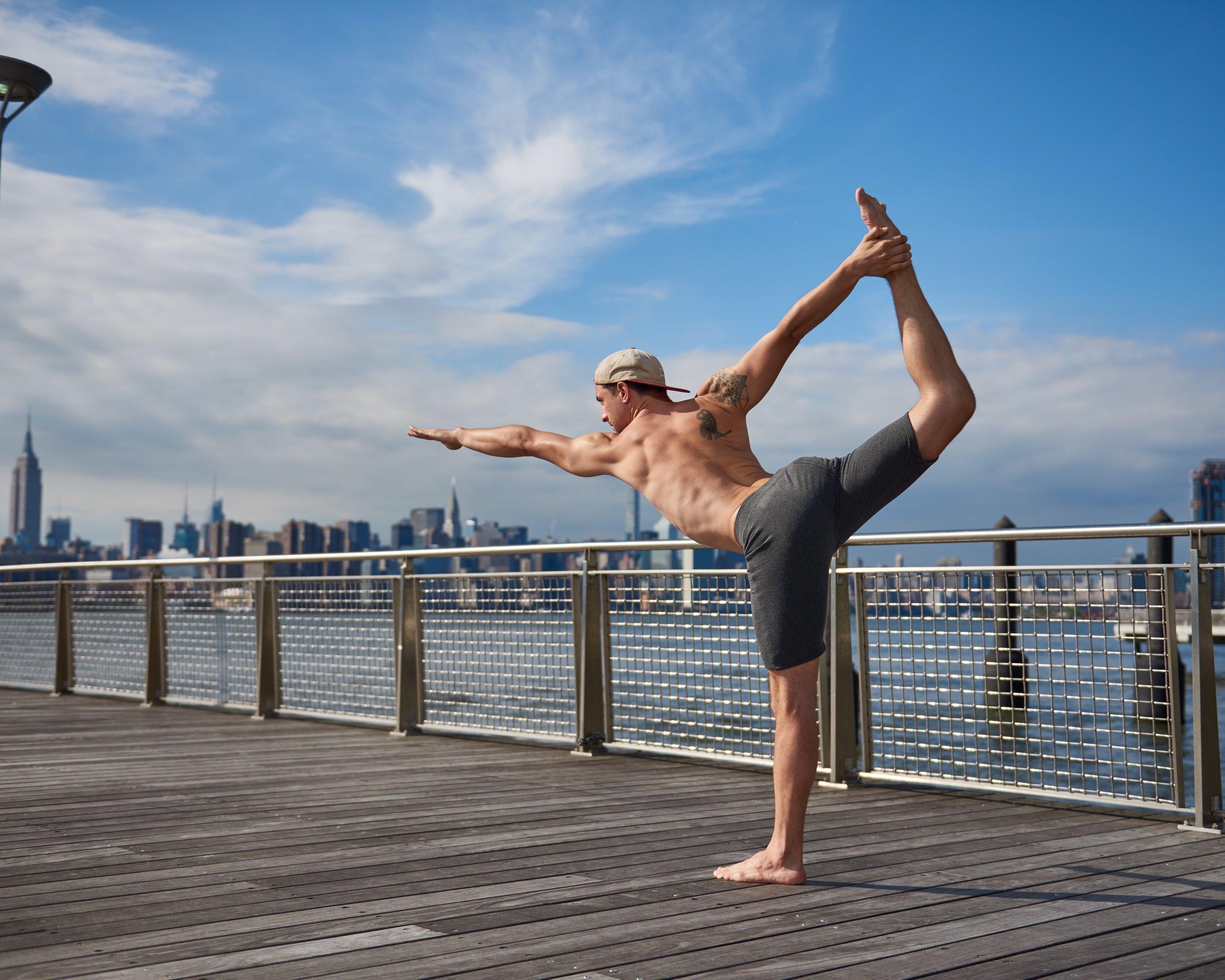 Yoga even on a boardwalk with your Warrior Wear Gear!