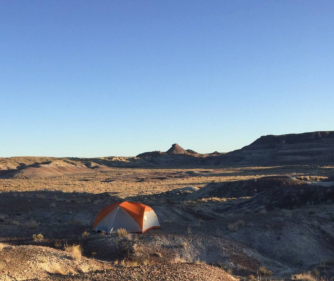 Undecided about where to camp at  Petrified Forest National Park,  a ranger warned us about muddy conditions and advised us to hike on the south side of the park. We were glad we did, enjoying solitude and sunset from our backcountry site.