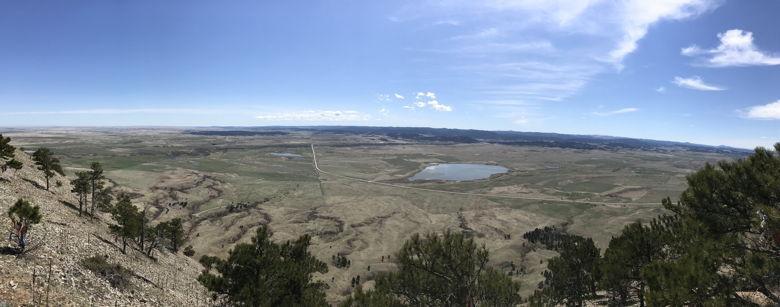 The view outward across South Dakota from the summit of Bear Butte Mountain.