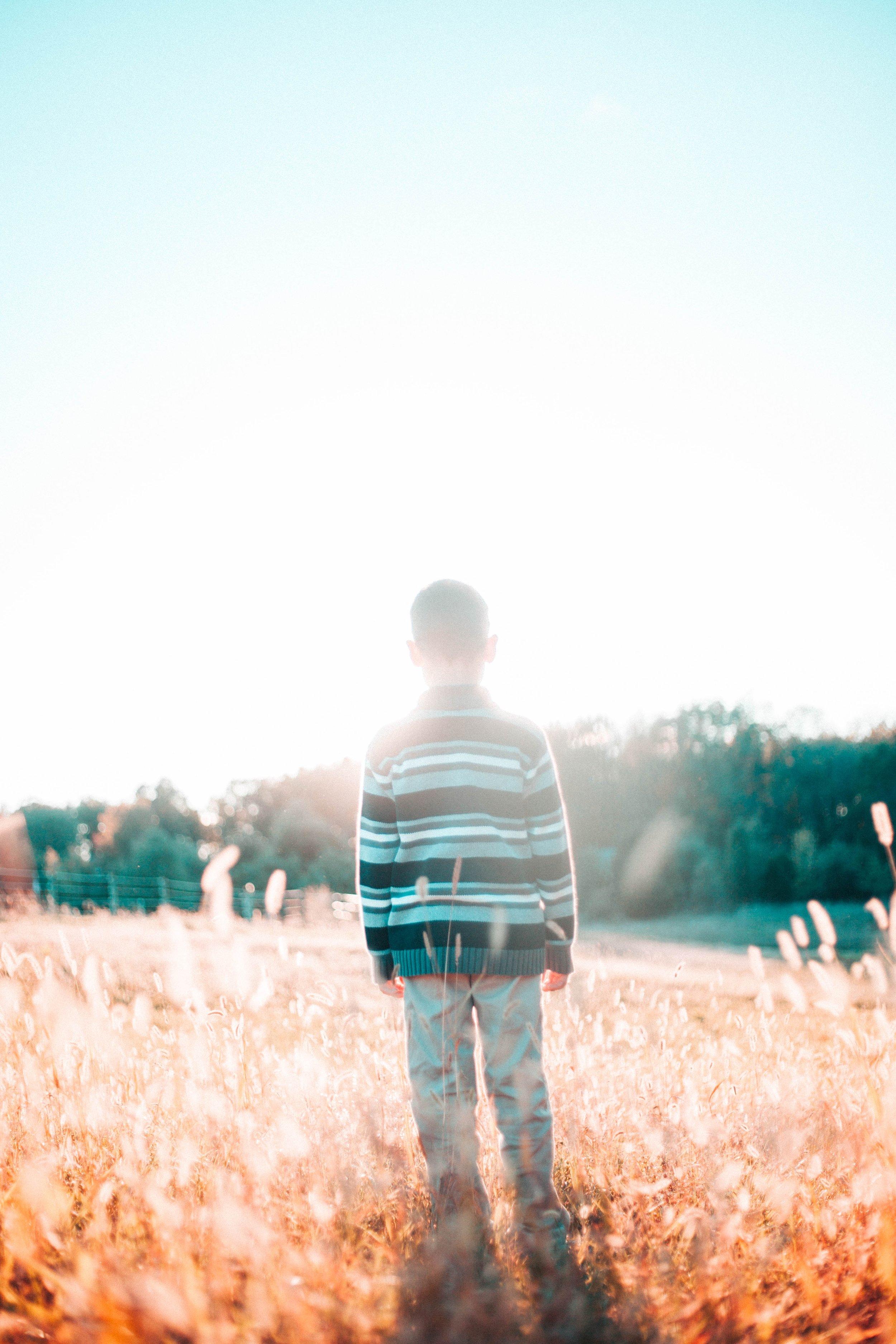 Boy_facing_sunrise.jpg