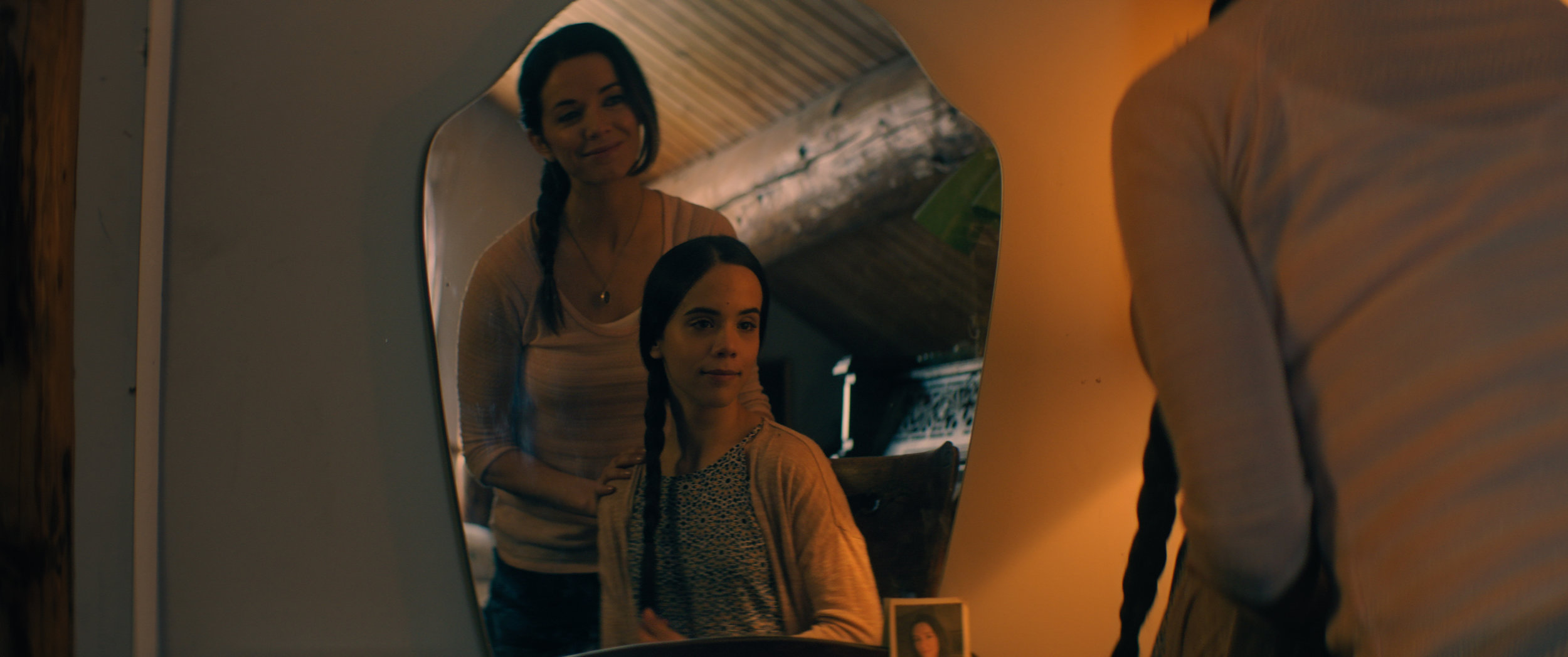 Michelle Morgan (Maria) and Sophia Lauchlin Hirt (Arielle) bond as Mother-Daughter in Ice Blue.
