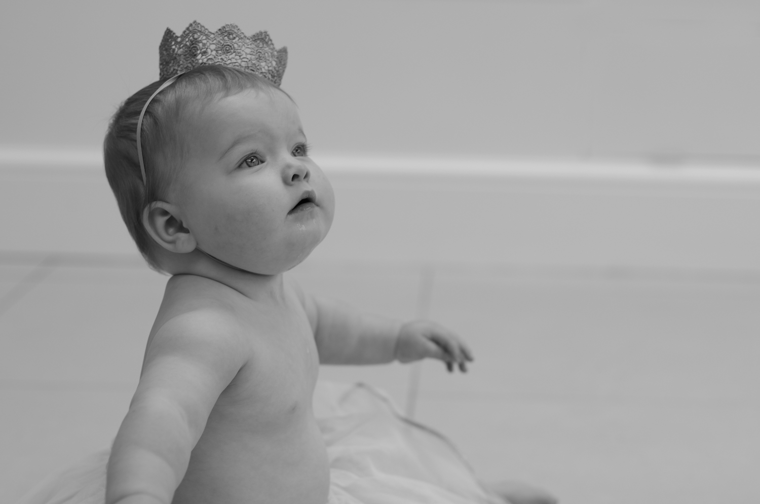 Photograph of baby in a shoot to celebrate 1st birthday, by photographer Evie Winter