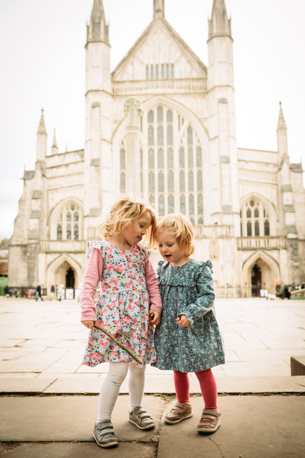 Two sisters in front of Winchester Cathedral Photoshoot.  Brockenhurst Photographer