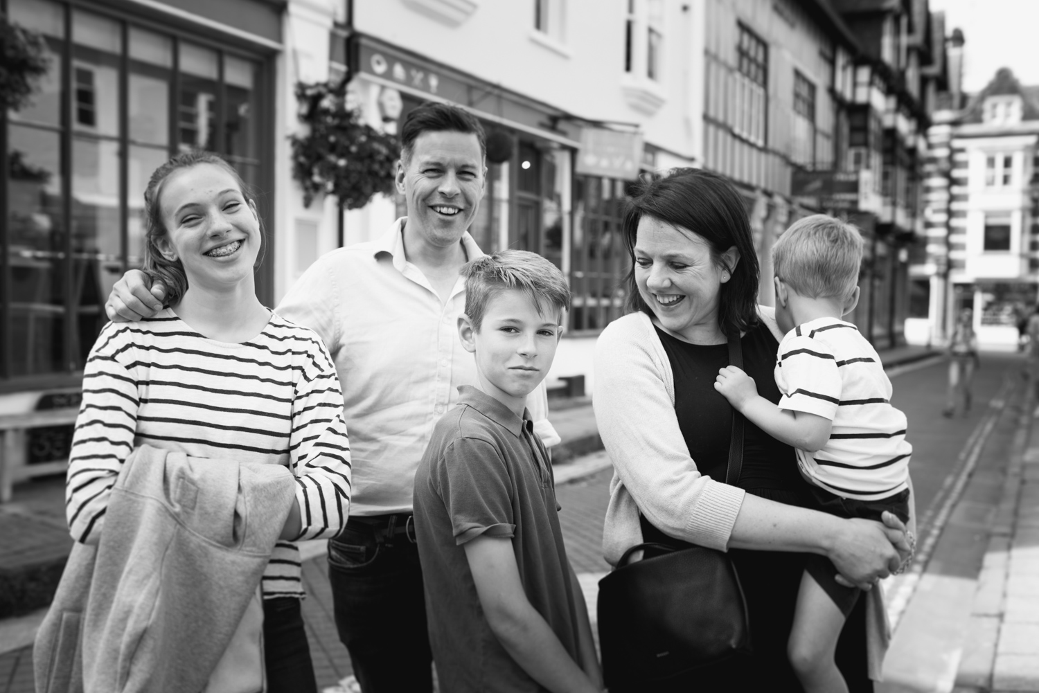 Black and White Family Portrait in Winchester City Centre by Hampshire Children's photographer Evie Winter