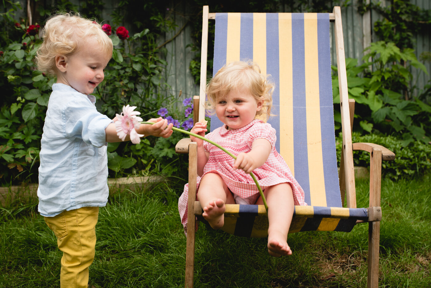 Siblings play in children's photoshoot London