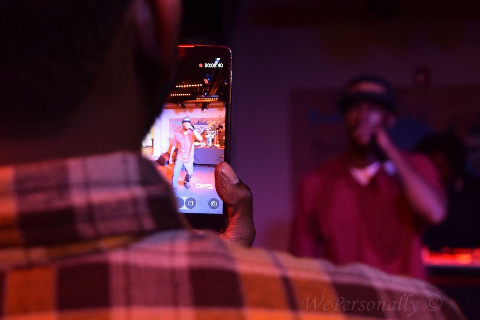 rapper on phone imurj.jpeg
