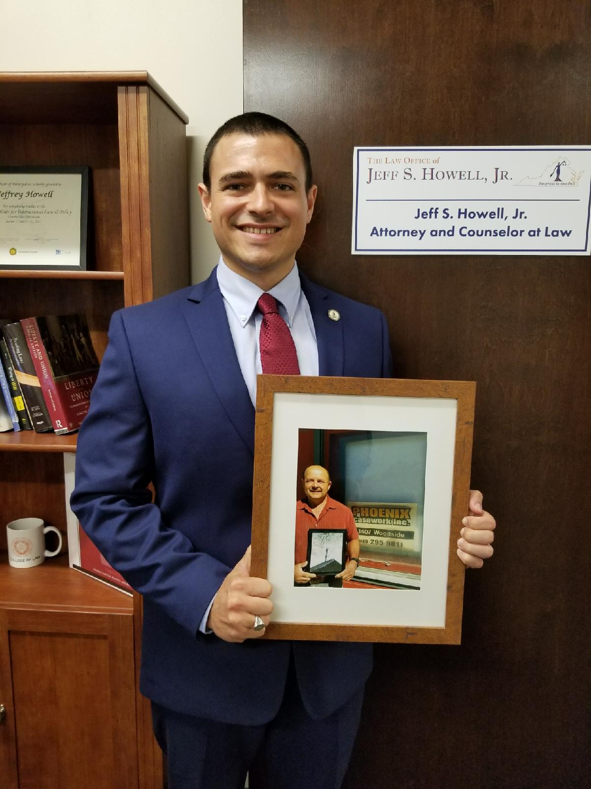Three generations in one photograph. . .   Jeff S. Howell, Jr., Esq. holding a picture of his Father, Jeff S. Howell, Sr., President and Founder of Phoenix Casework, Inc., who is holding a picture of his father, Eugene Howell standing on the shoulders of his brother, Phillip Howell, as they installed a television Antennae through their company, Howell's Antennae Service (circa 1954).