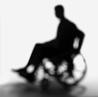 PHOTO: Blurry black silhouette of a person in a wheelchair