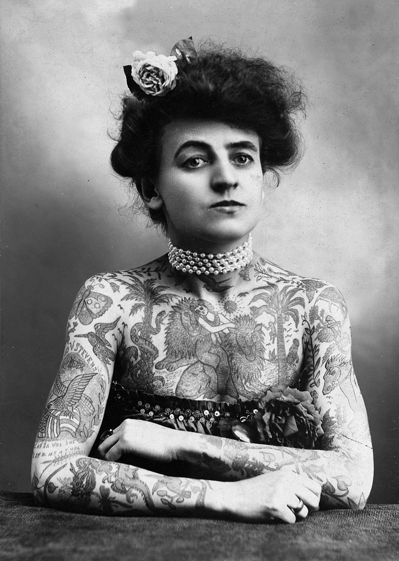 Maud Stevens Wagner with arms and chest covered in tattoos. Click  HERE  for the source.
