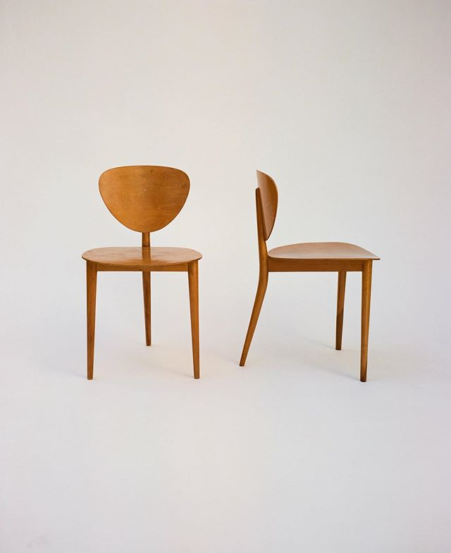"""Max Bill, Tripod chairs, 1949. Produced by Swiss manufacturer AG Möbelfabrik Horgenglarus. The design for this chair was based on an equilateral triangle, in line with Bill's interest in the laws of geometry and nature. Bill studied at the Bauhaus Dessau under László Moholy-Nagy, Josef Albers and Wassily Kandinsky during a time that the school was heavily focused on the integration of design and industry. This influence, along with a general sense of social responsibility, carries through Bill's extensive body of work that includes architecture, sculpture, painting, industrial and graphic design, and written theory. To Bill, the """"valid"""" final form of an object had to be the result of all functions; and this included formal and aesthetic functions. The Tripod chair embodies this principle as a functional, everyday object that is equally graceful/sculptural as it is economical. Bill saw art as (in his own words) an """"object of intellectual use."""" #maxbill"""