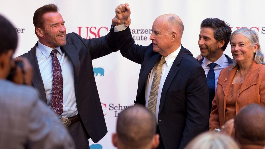Former Gov. Arnold Schwarzenegger, left, a Republican, and Democratic Gov. Jerry Brown