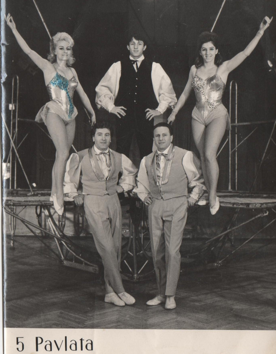 Sacha (above center) in a promo photo for his family's trampoline act.