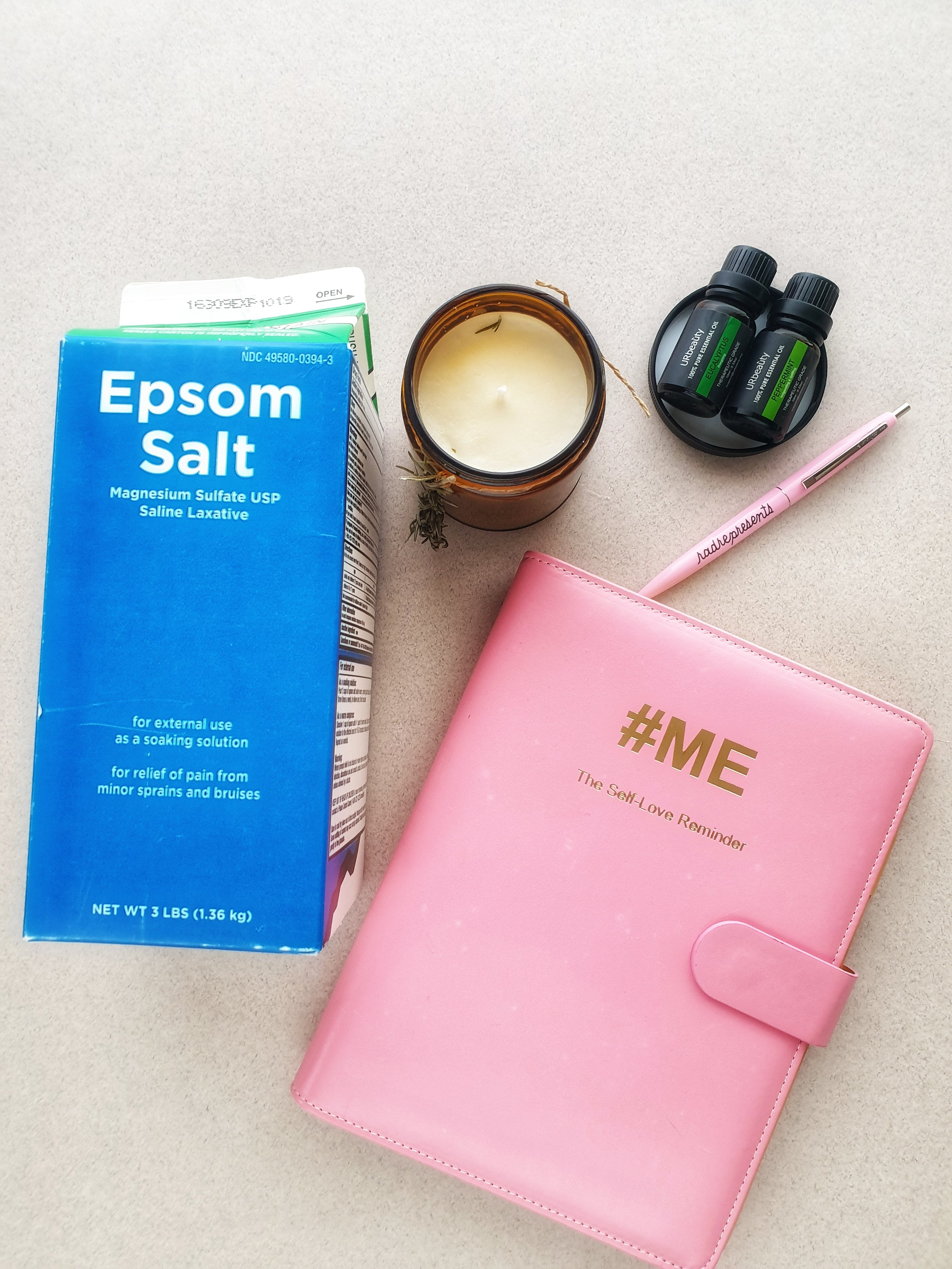 Epsom bath salts, peppermint and eucalyptus essential oils and a self love reminder journal.