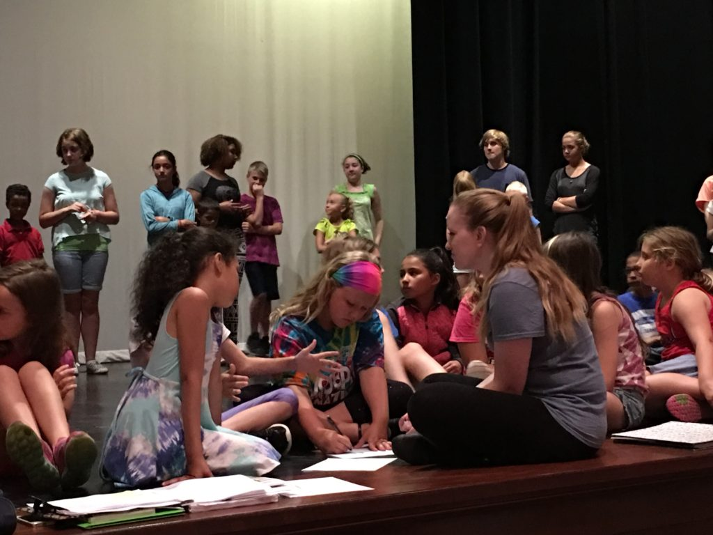 """Erie, PA ( July 06, 2016) Footlights' Karina Work going over lines of with students at Strong Vincent High School, where the students are practicing for The Footlights Theatre Program production of """"Disney's Beauty and the Beast"""". (Photo Credit: Lauren Benzo)"""