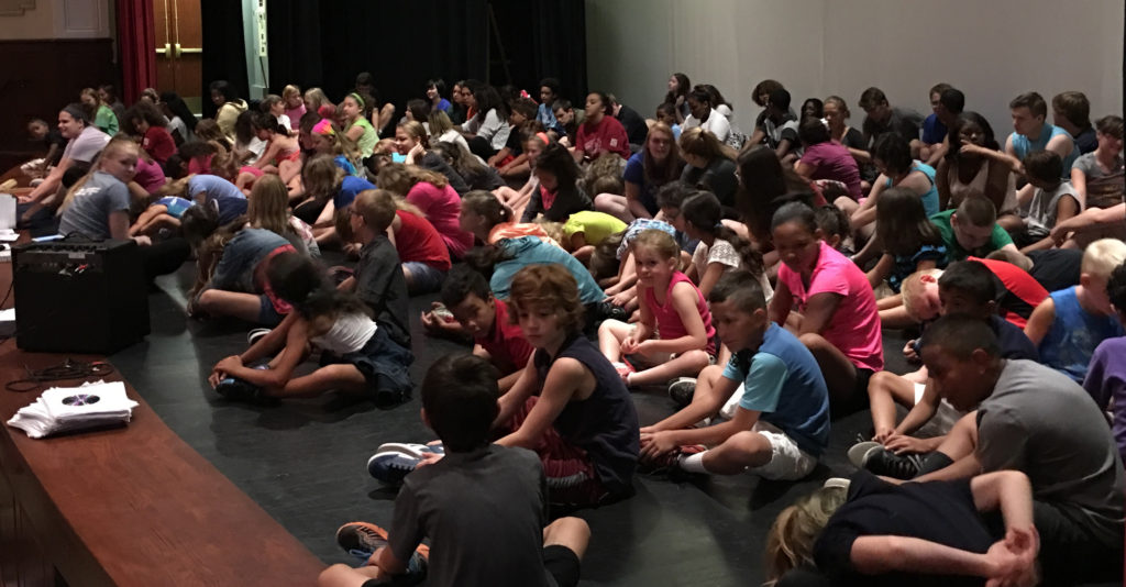 """Erie, PA ( July 06, 2016) Students are taking a break before going into the second act The Footlights Theatre Program production of """"Disney's Beauty and the Beast"""" in the auditorium of Strong Vincent High School. (Photo Credit: Lauren Benzo)"""
