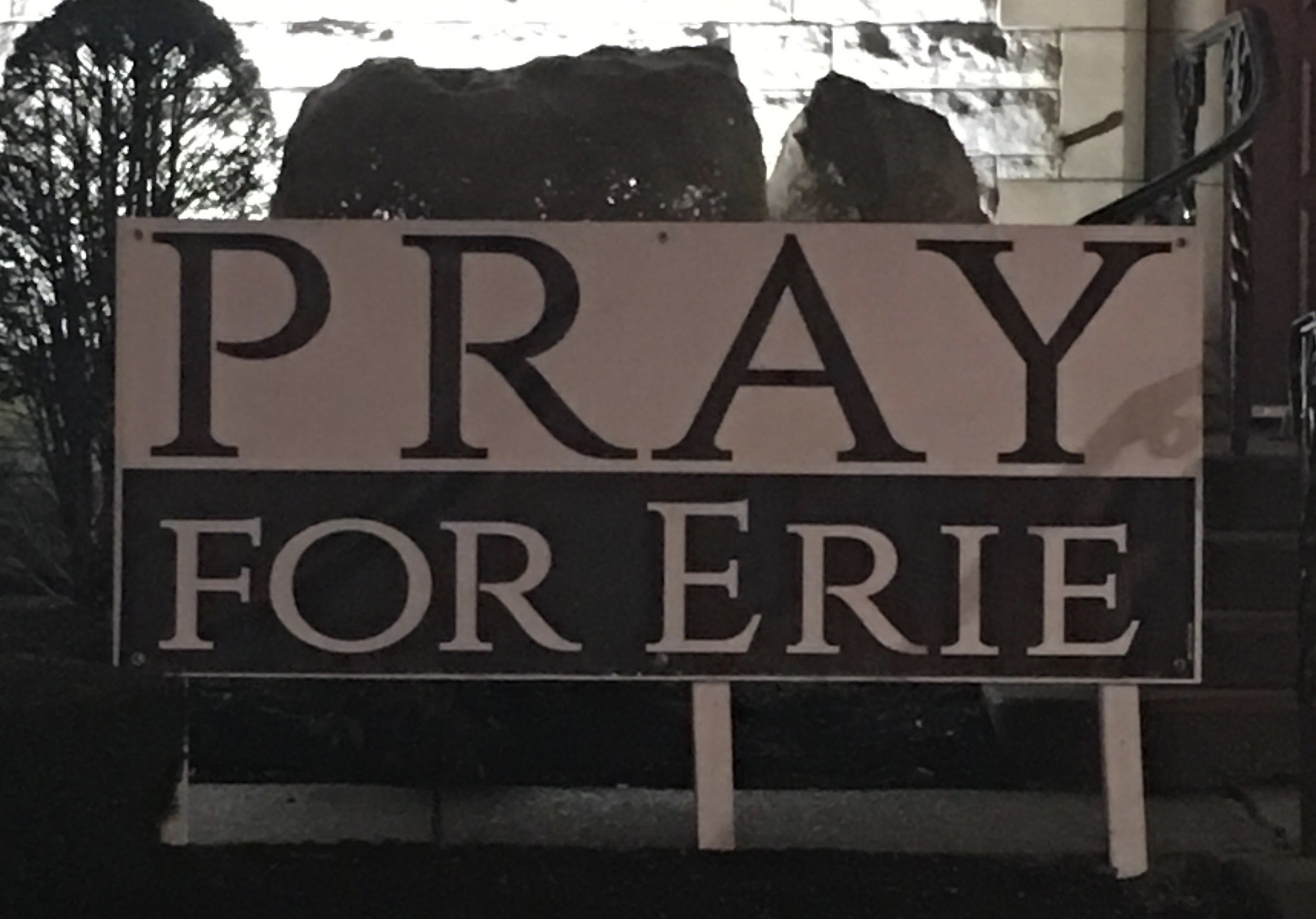 """Erie, PA (January 19, 2017) A sign that states """"Pray For Erie"""" stands across the street of the Erie County Courthouse on West Sixth Street in Erie, PA. (Photo Credit: Lauren Benzo )"""