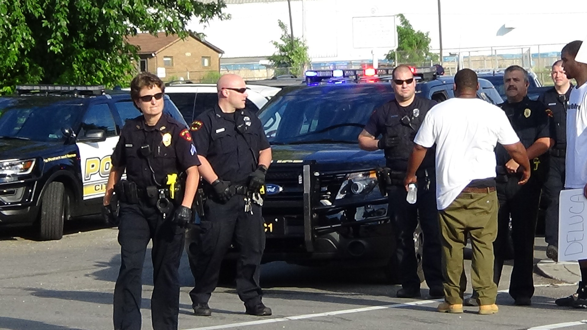 Erie, PA (July 22, 2016) Take Back Out Street Movement-Erie, PA members speaking to Erie Police Officers during a peace rally on the corner of East 12th and Wayne Street in Erie, PA. (Photo Credit: Lauren Benzo )