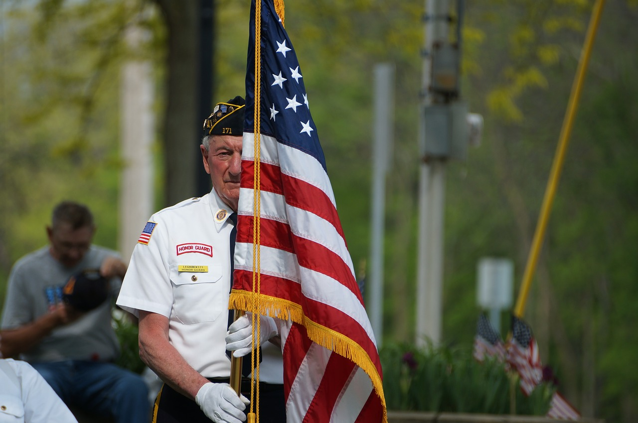 veteran holding up an american flag