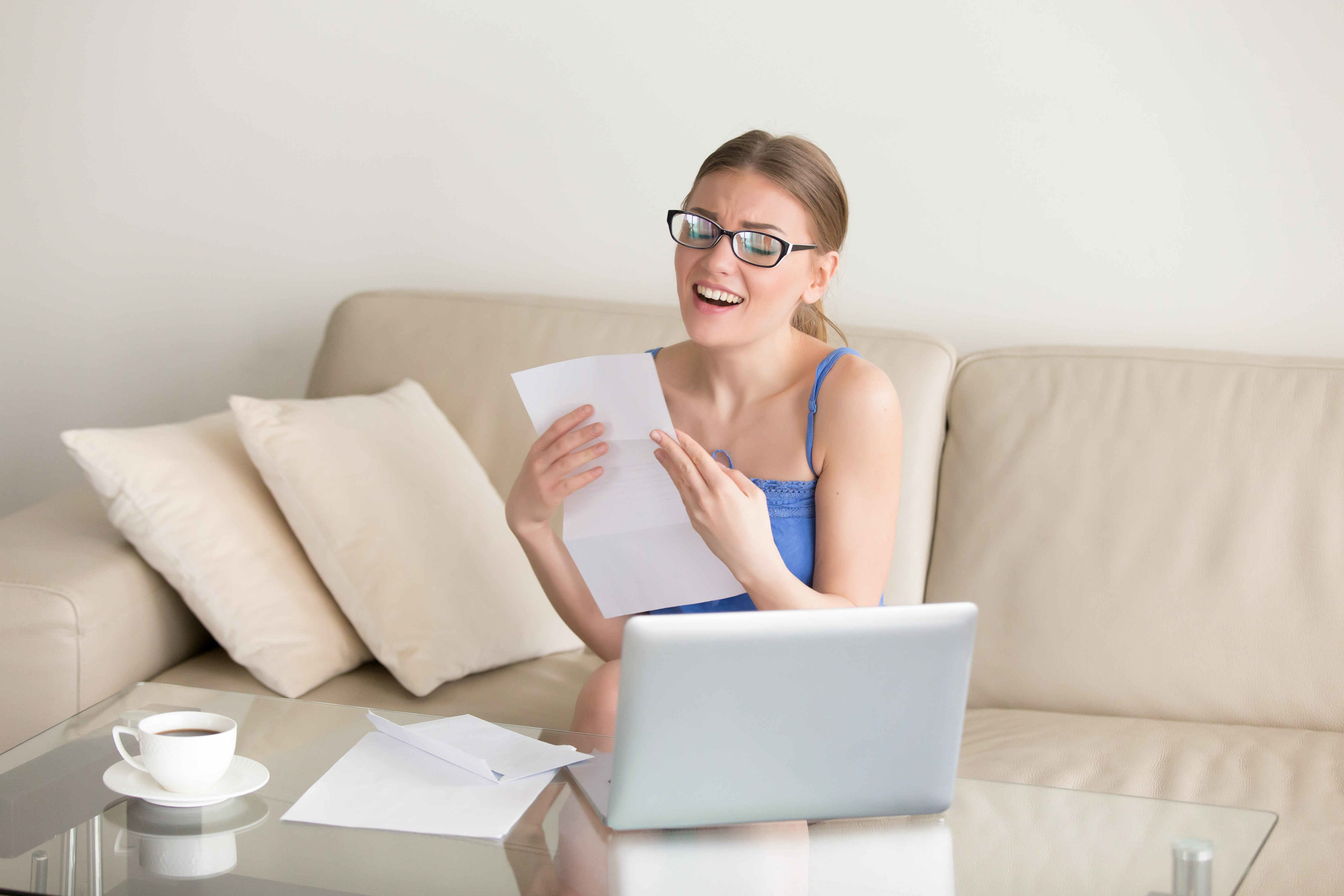young woman with glasses enjoying reading a document