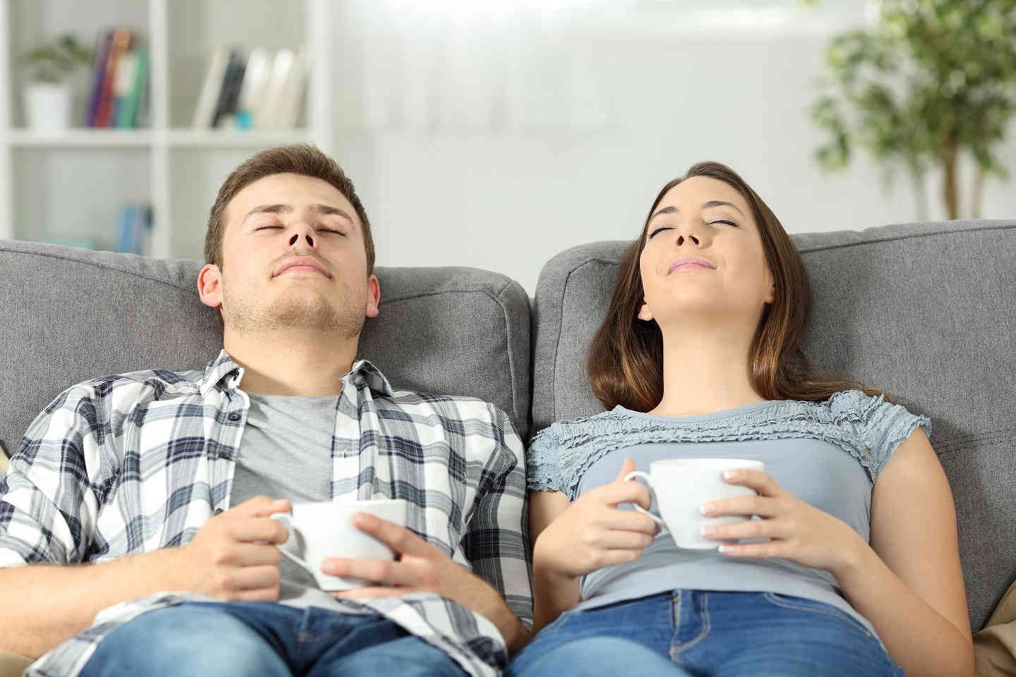 couple relaxing with coffee on couch
