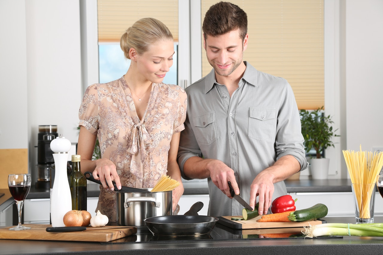 couple preparing meal together in the kitchen