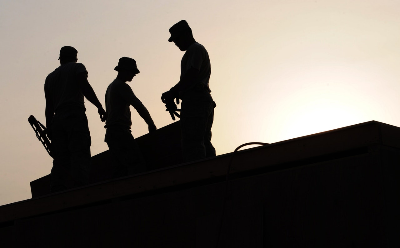 silhouette of men working