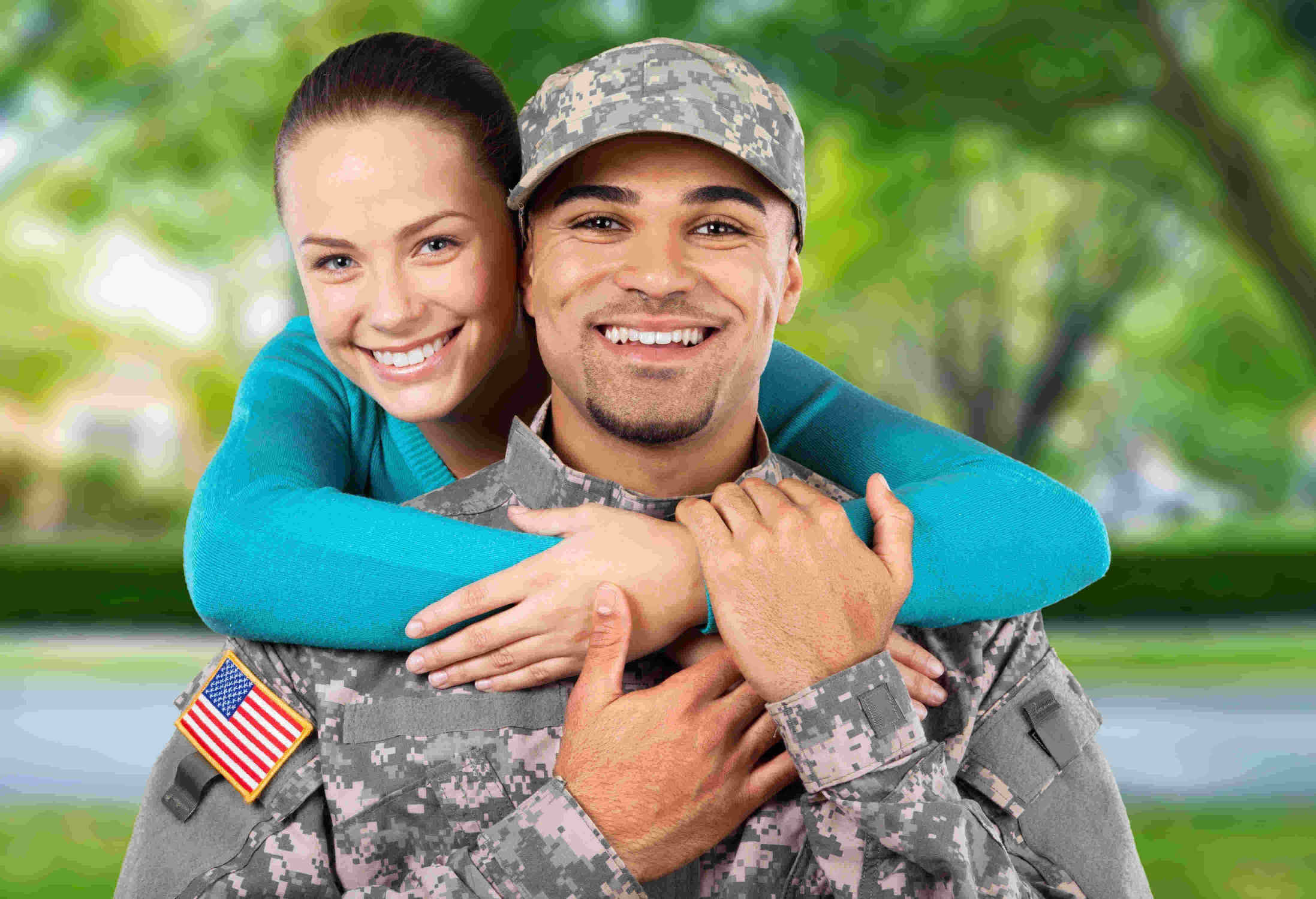 wife with arms around soldier