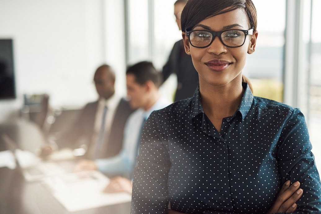 woman smiling office meeting in background