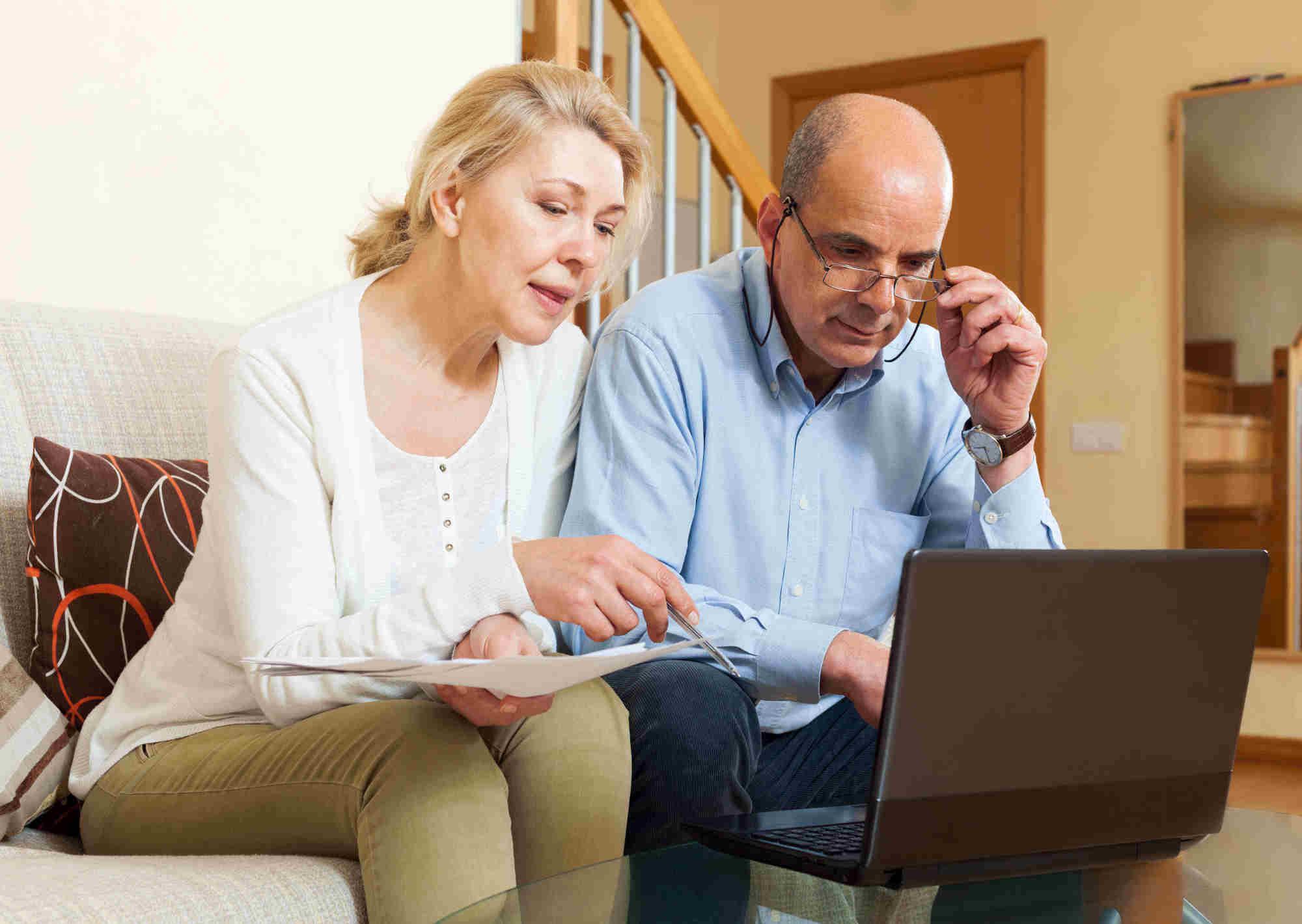 mature couple viewing laptop