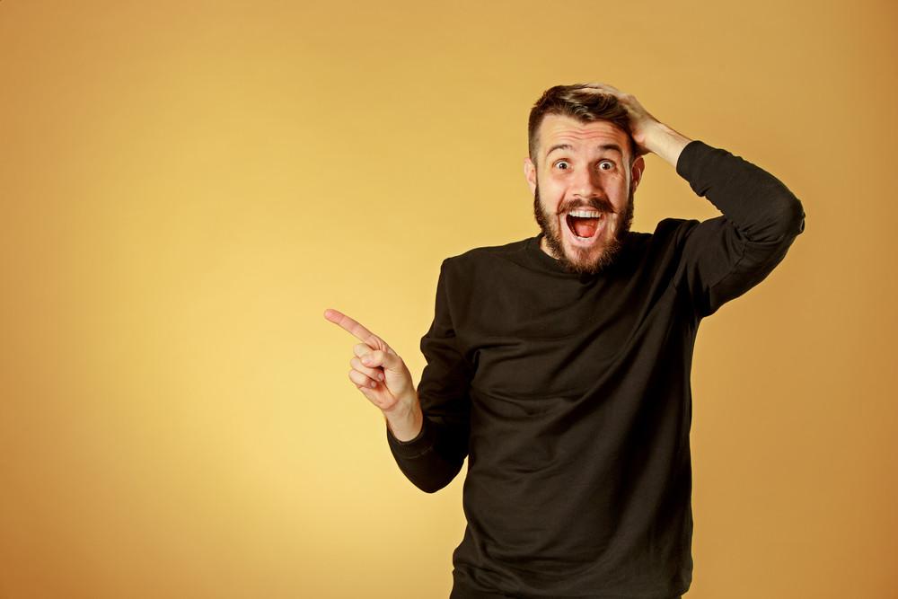 man with surprised expression in orange background.jpg