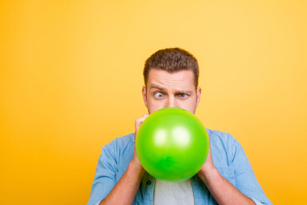 man blowing green ballon (1).jpg